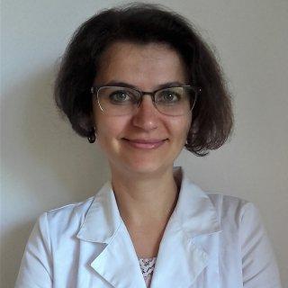 Dr.  Oana Maria Fiscutean