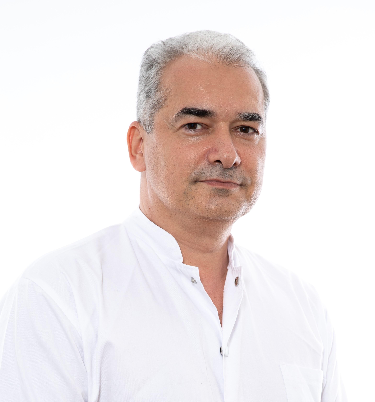 Dr. George Jinescu