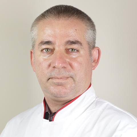 Dr. Marius Frinculescu